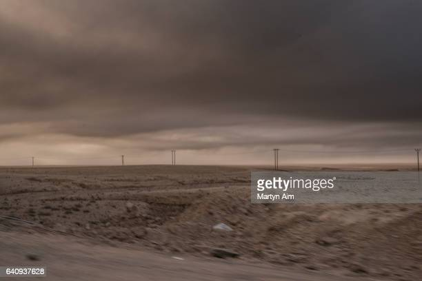 Smoke from burning oil wells set alight by the Islamic State fills the air on November 11 2016 in Nineveh northern Iraq