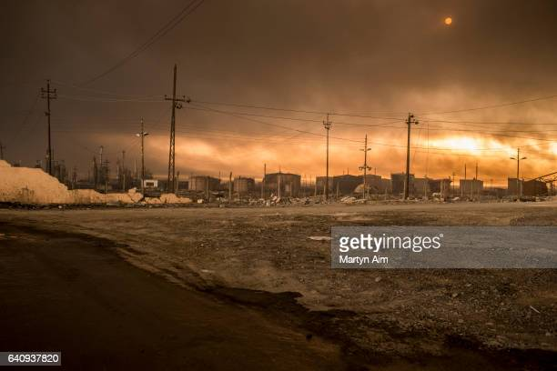 Smoke from burning oil wells set alight by the Islamic State in August 2016 fills the air on November 11 2016 in Al Qayyarah northern Iraq
