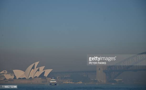 Smoke from bushfires blanket Sydney on November 19 2019 Sydney woke up to a thick blanket of smoke as New South Wales warns residents of the dangers...