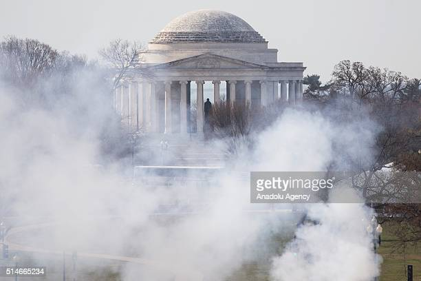 Smoke from ceremonial cannons rise in front of the Jefferson Memorial as President Barack Obama welcomes Canadian Prime Minister Justin Trudeau to...