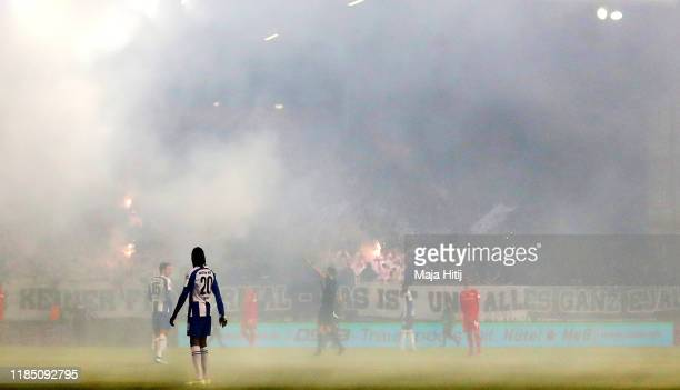 Smoke from flares are seen during the Bundesliga match between 1 FC Union Berlin and Hertha BSC at Stadion An der Alten Foersterei on November 02...
