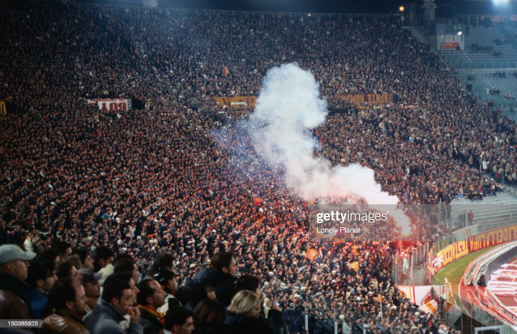 Smoke from flares in the Curva Sud stand where the most passionate fans sit, at the AS Roma vs Ajax Amsterdam match at Champions League Game Stadio Olimpico. : Stock Photo