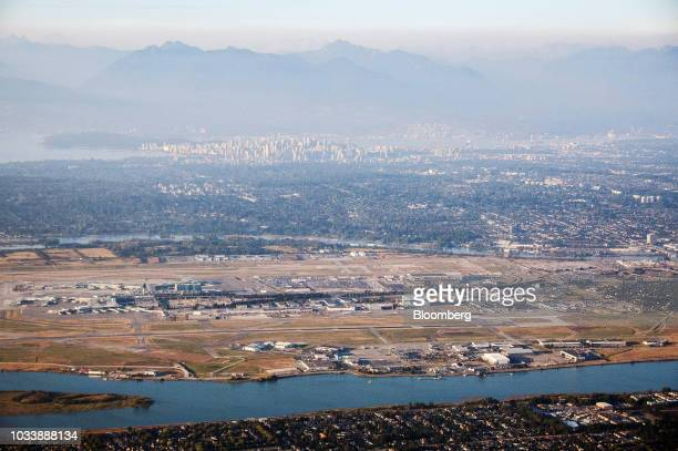Smoke from late summer wildfires is seen over Vancouver International Airport and the downtown area in this aerial photograph taken above Vancouver,...