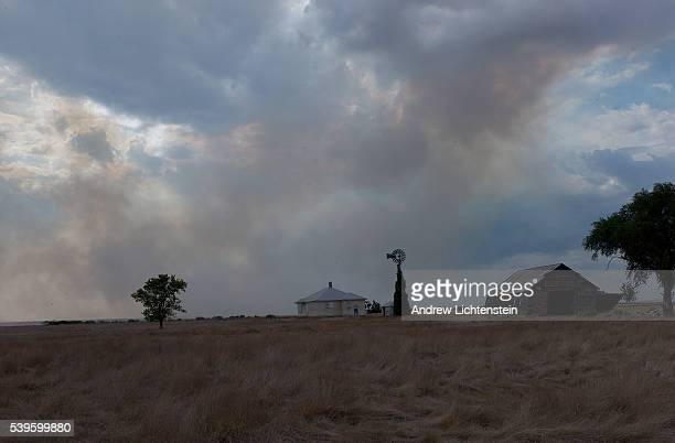 Smoke from prairie fires drifts past an abandoned farm house The dry conditions brought on by the drought have threatened many farms with wildfires...