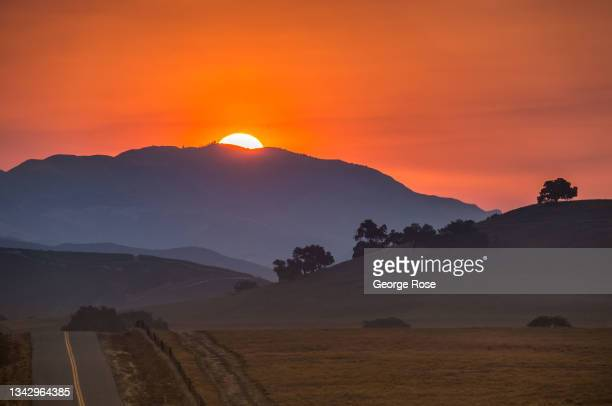 Smoke from several fires to the north creates a colorful, surreal sunrise in Santa Barbara County's Wine Country as viewed on September 25 near Santa...