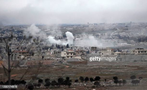 Smoke from Syrian government forces shelling is pictured over Khan al-Asal in the Rashideen al-Rabea area in Syria's Aleppo province on February 11,...