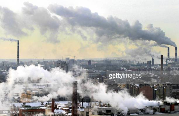 A smoke from the chimneys billow over St Petersburg 03 March 2005 Russia's greenhouse gas emissions fell by up to 38 percent between 1990 and 1999...