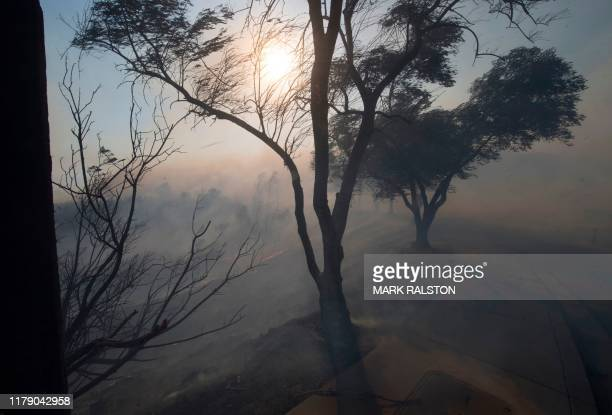 Smoke from the Easy Fire threaten the Reagan Library in Simi Valley California on October 30 2019 Firefighters made progress battling a fire raging...