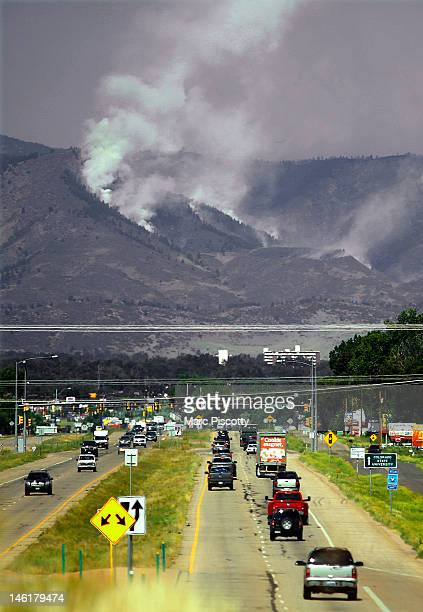 Smoke from the High Park Fire rises from the hillside looking west along Colorado State Highway 14 on June 11 2012 in Fort Collins Colorado The High...