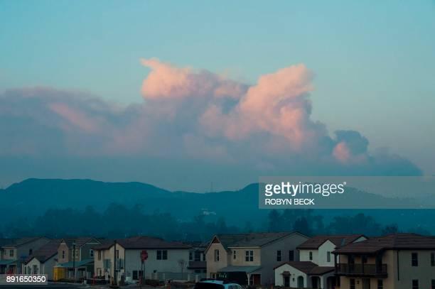 Smoke from the Thomas Fire is seen from Santa Paula California as it rises over Ventura and Santa Barbara counties December 12 2017 The Thomas Fire...