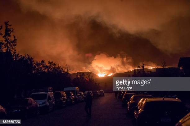 Smoke from the Thomas Fire rises over a residential neighborhood on December 5, 2017 in Ventura, California. Thousands have been evacuated and many...