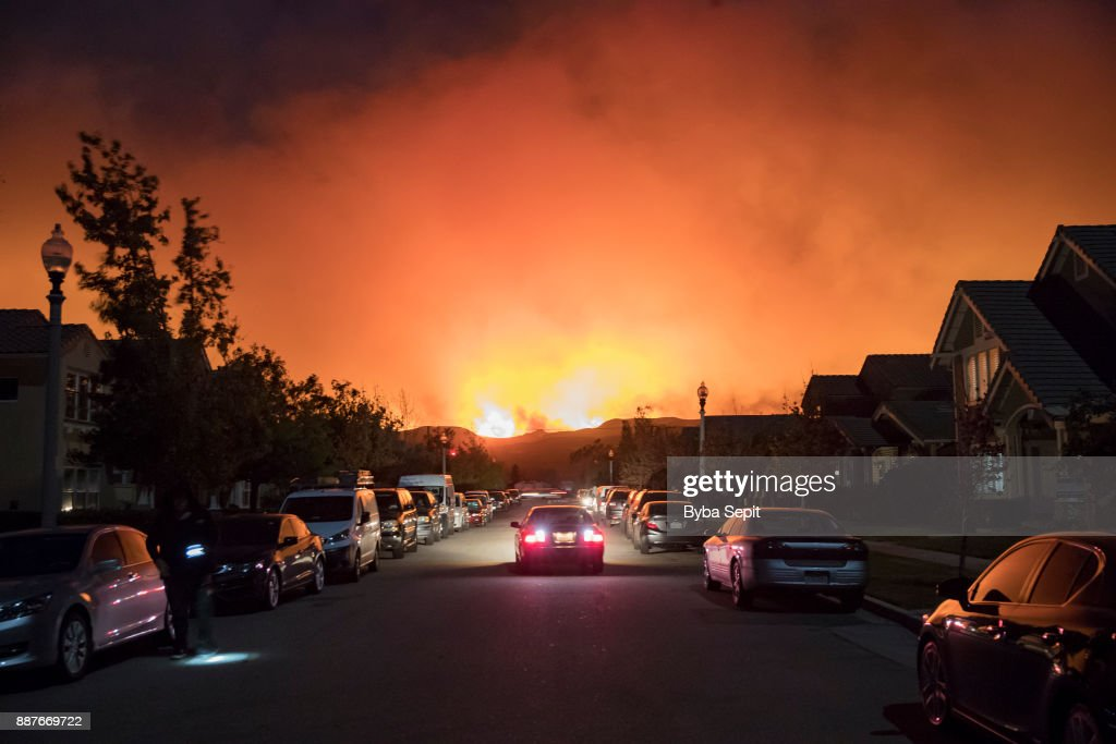 Smoke from the Thomas Fire rises over a residential neighborhood on December 5, 2017 in Ventura, California. Thousands have been evacuated and many surrounding towns are without power as the fire continues to grow.