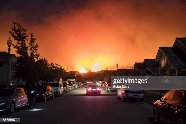 Smoke from the Thomas Fire rises over a residential neighborhood on December 5 2017 in Ventura California Thousands have been evacuated and many...
