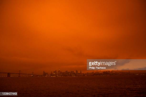 Smoke from various wildfires burning across Northern California mixes with the marine layer, blanketing the San Francisco skyline in darkness and an...