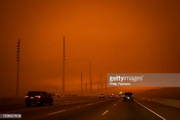 Smoke from various wildfires burning across Northern California mixes with the marine layer creating darkness and an orange glow, seen from the...