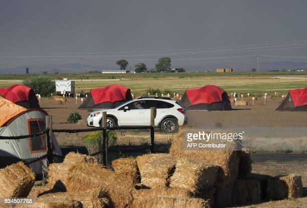 Smoke from wildfires darkens the sky as early visitors arrive in Madras Oregon on August 17 to see the total solar eclipse on August 21 The western...