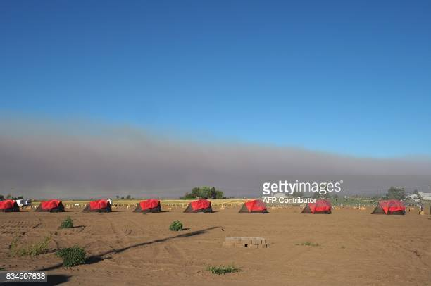 Smoke from wildfires darkens the sky as tents await visitors in Madras Oregon on August 17 ahead of the total solar eclipse on August 21 The western...
