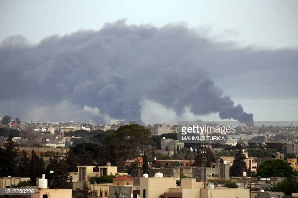Smoke fumes rise above buildings in the Libyan capital Tripoli, during reported shelling by strongman Khalifa Haftar's forces, on May 9, 2020