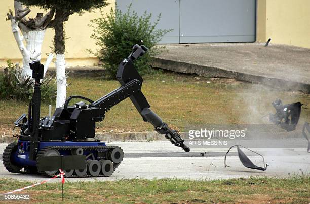 Smoke goes up in the air as a remotecontrolled Greek army robot destroys a suitcase containing a mock bomb hidden inside during a presentation in...