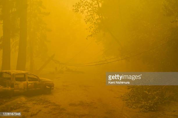 Smoke hangs low in the air along Highway 236 on Saturday, Aug. 22, 2020 in Boulder Creek, CA. The CZU August Lightning complex fires tore through Big...
