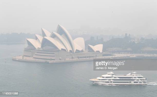 Smoke haze is seen over Sydney Harbour with the Opera House hardly visible on December 10 2019 in Sydney Australia Smoke haze hangs over the city as...