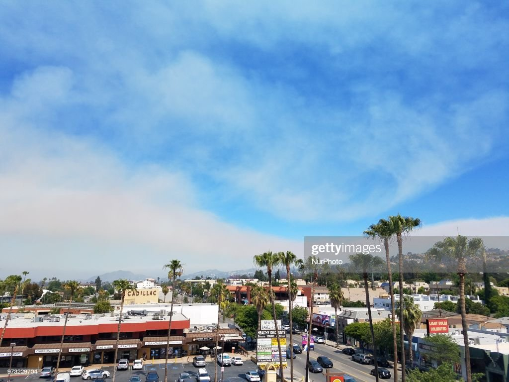 Smoke increases throughout the San Fernando Valley in Los Angeles as fire fighters battle to contain the Portola Fire, in Sherman Oaks, CA, USA, on June 12, 2018.
