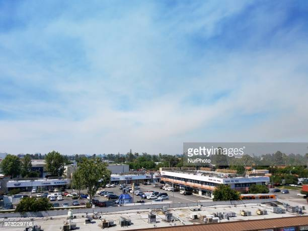 Smoke increases throughout the San Fernando Valley in Los Angeles as fire fighters battle to contain the Portola Fire in Sherman Oaks CA USA on June...