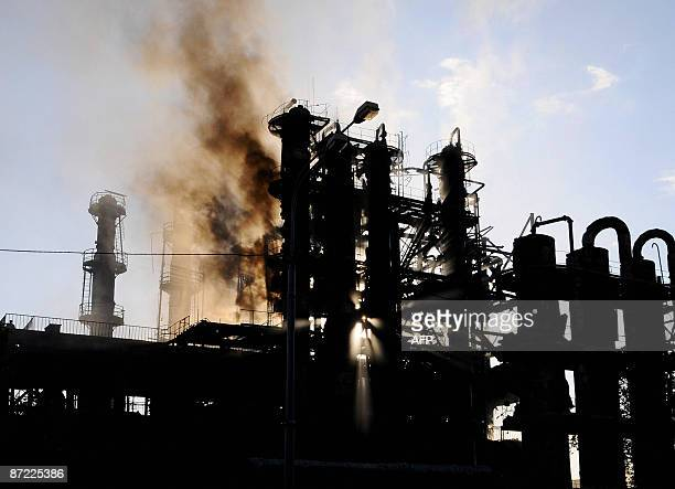 A smoke is seen at rectifying columns of the Nairit plant in Yerevan on May 14 2009 A fire at a synthetic rubber plant in the Armenian capital...