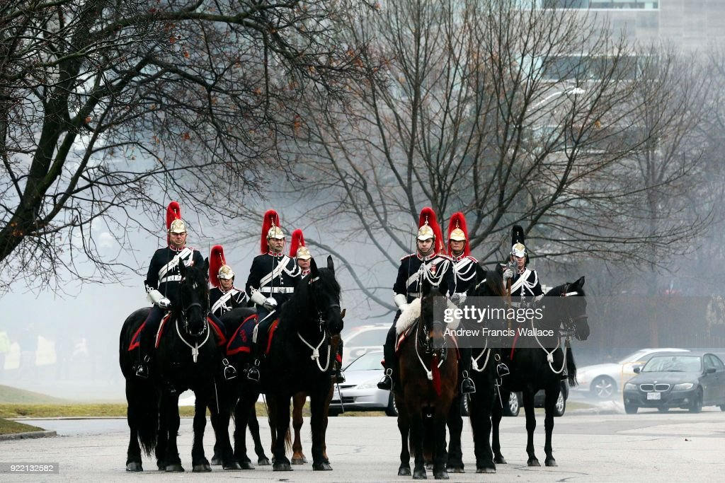 TORONTO, ON - FEBRUARY 20 - Smoke is seen behind the Governor General's Horse Guards after a 21-gun salute for the arrival to Queen's Park of Her Excellency the Right Honourable Julie Payette, Governor General of Canada, during a visit to Toronto, February 20, 2018.