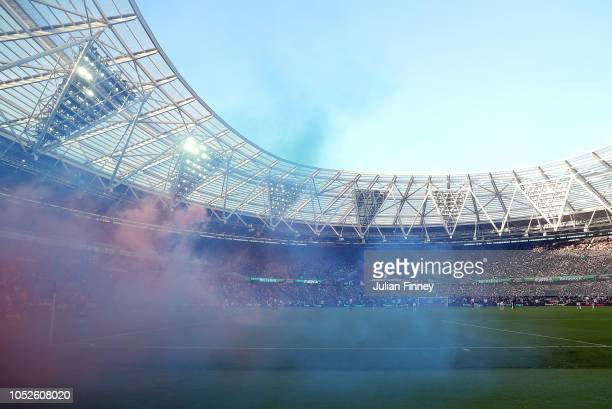 Smoke is seen during the Premier League match between West Ham United and Tottenham Hotspur at London Stadium on October 20 2018 in London United...