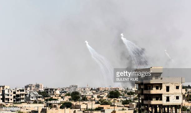 Smoke is seen following an airstrike on the western frontline of Raqa on July 17 during an offensive by the USbacked Syrian Democratic Forces a...