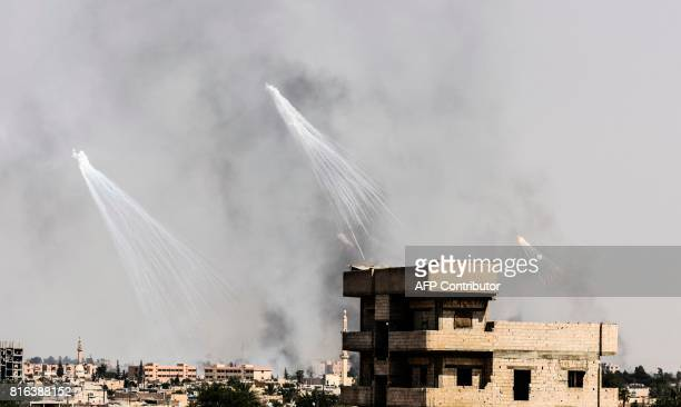 TOPSHOT Smoke is seen following an airstrike on the western frontline of Raqa on July 17 during an offensive by the USbacked Syrian Democratic Forces...