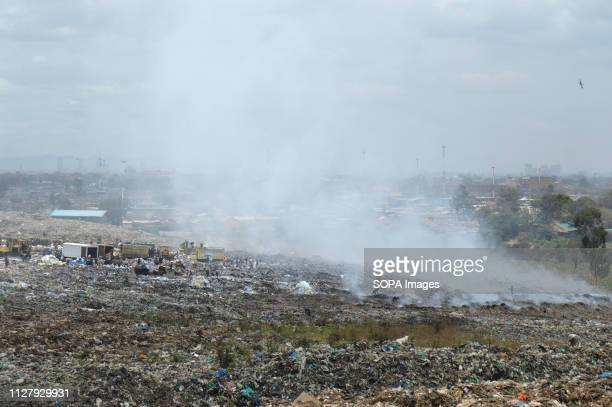 Smoke is seen from burning waste in Nairobi's Dandora Dump site Nairobi generates an average of 3000 tons of solid waste every day from industries...