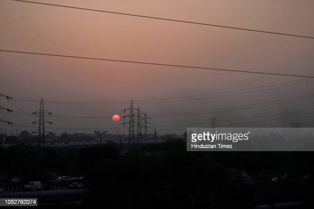 Smoke is seen in the air as sun sets in the backdrop on October 22 2018 in New Delhi India Air pollution continues to be above hazardous levels in...