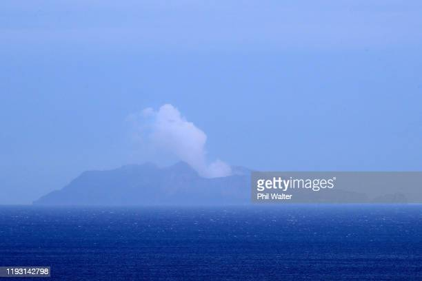 Smoke is seen over White Island on December 11 2019 in Whakatane New Zealand Six people are confirmed dead and several people are missing following a...