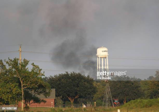 Smoke is seen rising from the Arkema chemical manufacturing and storage facility that burst into flames after Hurricane Harvey's floodwaters knocked...