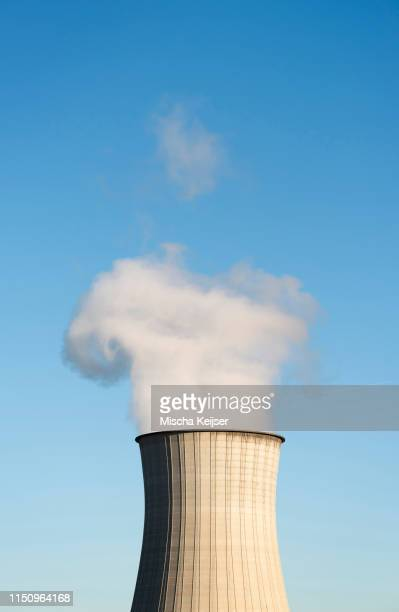 smoke leaving chimney, cooling tower - cooling tower stock pictures, royalty-free photos & images