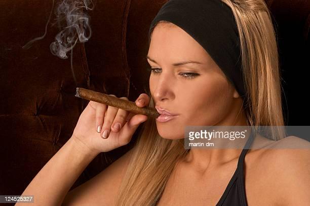 smoke - beautiful women smoking cigars stock photos and pictures