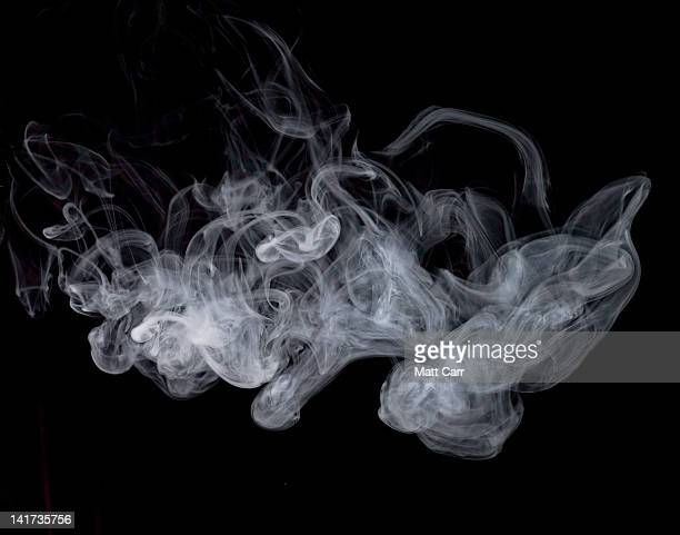 smoke - smoking stock pictures, royalty-free photos & images