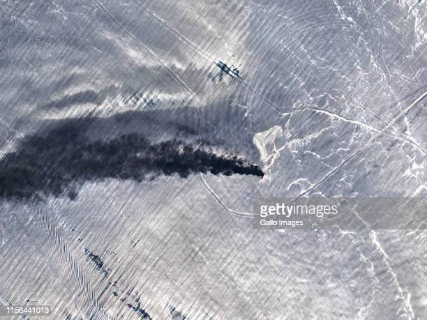 Smoke plume from a fire on the starboard side of the Norwegian owned oil tanker Front Altair in the Gulf of Oman near the Strait of Hormuz