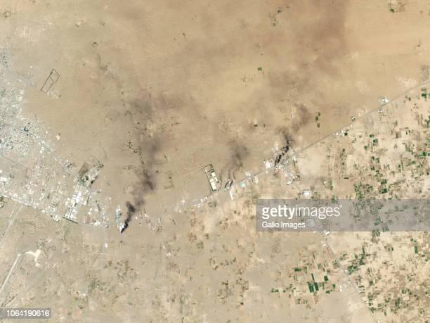 Smoke plumes visible along the main road of the port city of Hudaydah Yemen