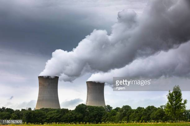 smoke pollution flows from an industrial smoke stack chimney - atomic imagery stock pictures, royalty-free photos & images