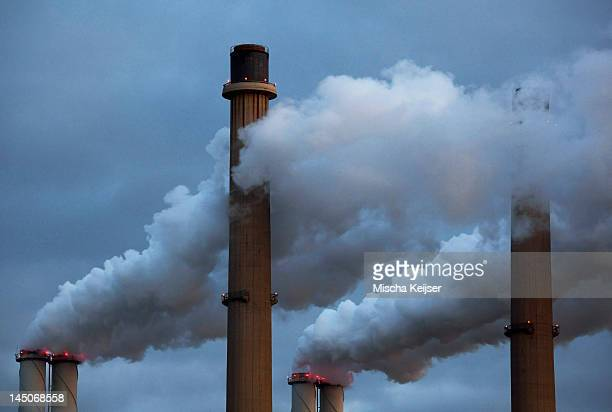 Smoke pouring from factory smokestacks