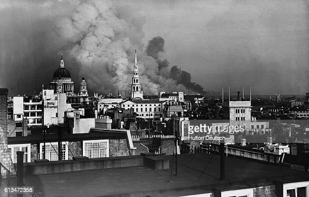 Smoke pours from a building near St Paul's Cathedral during the Blitz bombing campaign in London September 1940