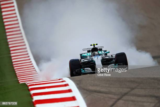 Smoke pours from the back of Valtteri Bottas driving the Mercedes AMG Petronas F1 Team Mercedes F1 WO8 during practice for the United States Formula...
