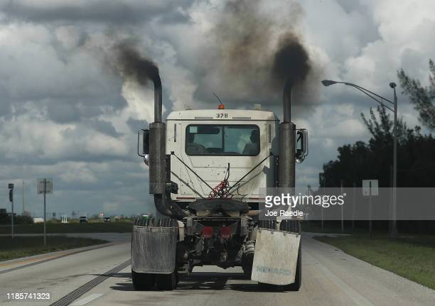 Smoke pours from the exhaust pipes on a truck on November 05 2019 in Miami Florida As the Trump administration officially withdraws from the Pairs...