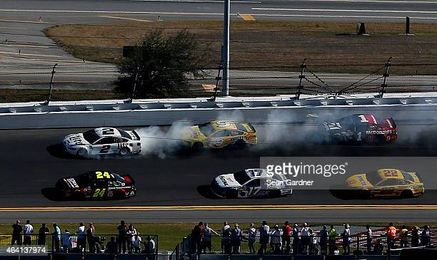 Smoke pours from the Miller Lite Ford driven by Brad Keselowski during the NASCAR Sprint Cup Series 57th Annual Daytona 500 at Daytona International...