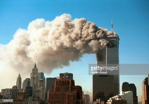 Smoke pours from the twin towers of the World Trade Center after they were hit by two hijacked airliners in a terrorist attack September 11, 2001 in...