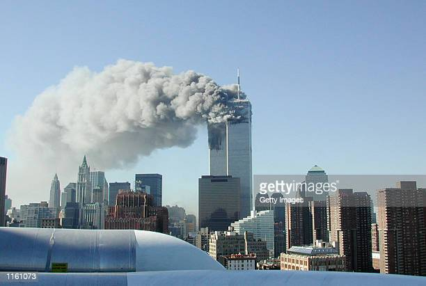Smoke pours from the World Trade Center after being hit by two planes September 11, 2001 in New York City.