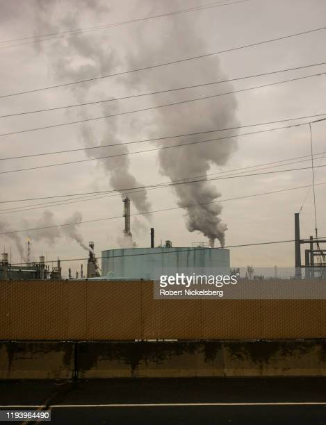 Smoke pours out of towers of the Phillips 66 Bayway oil refinery along the New Jersey Turnpike in Linden, New Jersey, December 11, 2019. The Phillips...